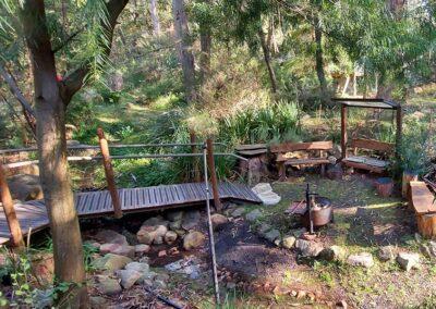 Private campfire area with walk bridge access