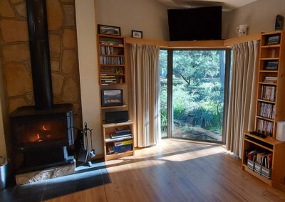Open plan living area with combustion wood heater
